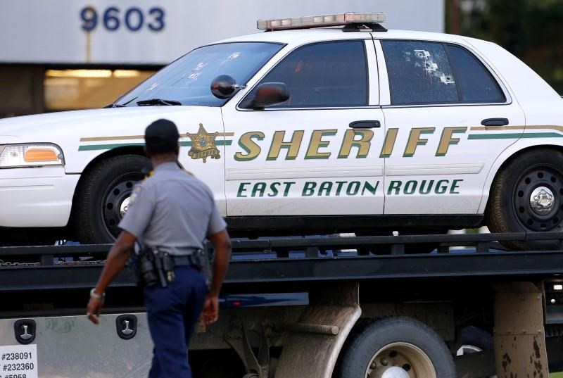An East Baton Rouge Sheriff vehicle is seen with bullet holes in its windows near the scene where police officers were shot in Baton Rouge, Louisiana, U.S. July 17, 2016.