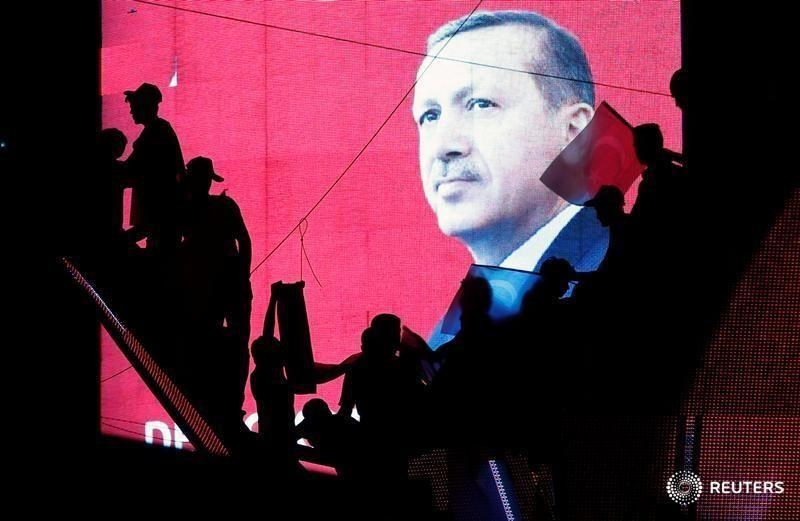 Turkish Supporters are silhouetted against a screan showing President Tayyip Erdogan during a pro-government demonstration in Ankara, Turkey, July 17, 2016.