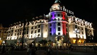 The Hotel Negresco on the Promenade des Anglais in Nice is illuminated in the colours of France's flag, in tribute to the victims of the Bastille Day attack