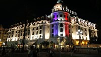 The Hotel Negresco on the Promenade des Anglais in Nice is illuminated in the colours of France's flag, in tribute to the victims of the Bastille Day attack. Photo: AFP