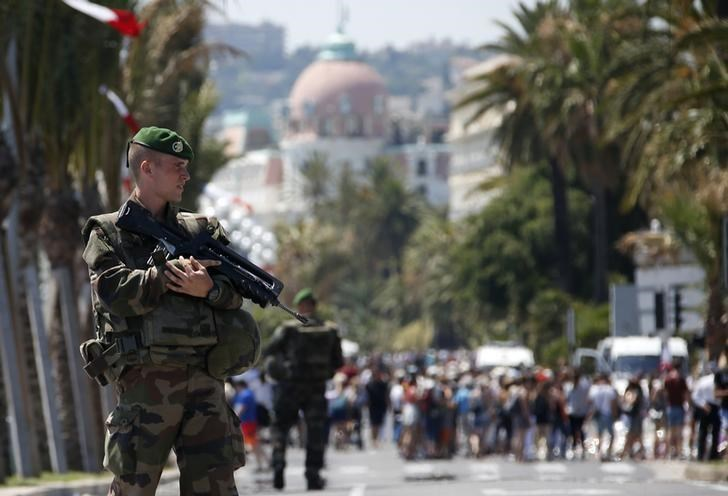 Soldiers from the French Foreign Legion patrol on the Promenade des Anglais on the third day of national mourning to pay tribute to victims of the truck attack on Bastille Day that killed scores and injured as many in Nice, France, July 18, 2016.