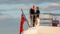 U.S. Vice President Joe Biden talks with Australian Foreign Affairs Minister Julie Bishop as they stand on a boat at sunset on Sydney Harbour, Australia, July 19, 2016.