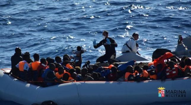 Migrants sit in their rubber dinghy during a rescue operation by Italian navy ship Borsini (unseen) off the coast of Sicily, Italy, in this handout picture courtesy of the Italian Marina Militare released July 19, 2016. Marina Militare/Handout via REUTERS