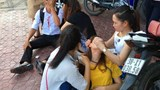 In a photo provided by the family, Nguyen Thi Thuong (yellow dress) is unconscious while Nguyen Minh Hoang is left with a bleeding nose after they were beaten by a group of men on Wednesday