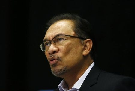 Malaysia's opposition leader Anwar Ibrahim speaks to the media ahead of the verdict in his final appeal against a conviction for sodomy in Kuala Lumpur