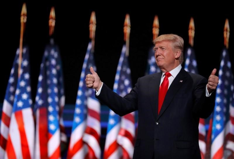 Republican U.S. presidential nominee Donald Trump gives two thumbs up as he arrives to speak during the final session at the Republican National Convention in Cleveland, Ohio, U.S. July 21, 2016.