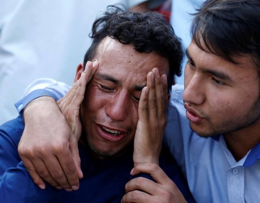 An Afghan man weeps outside a hospital after a suicide attack in Kabul, Afghanistan July 23, 2016.