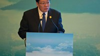 Lou Jiwei, China's Minister of Finance speaks at the High-level Tax Symposium held in Chengdu in Southwestern China's Sichuan province, Saturday, July 23, 2016.