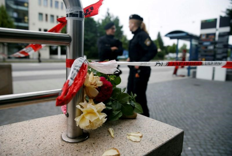 Flowers are placed near the Olympia shopping mall, where yesterday's shooting rampage started, in Munich, Germany, July 23, 2016.
