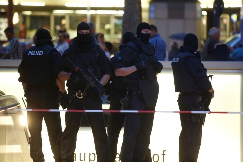 Special force police officers stand guard at an entrance of the main train station, following a shooting rampage at the Olympia shopping mall in Munich.