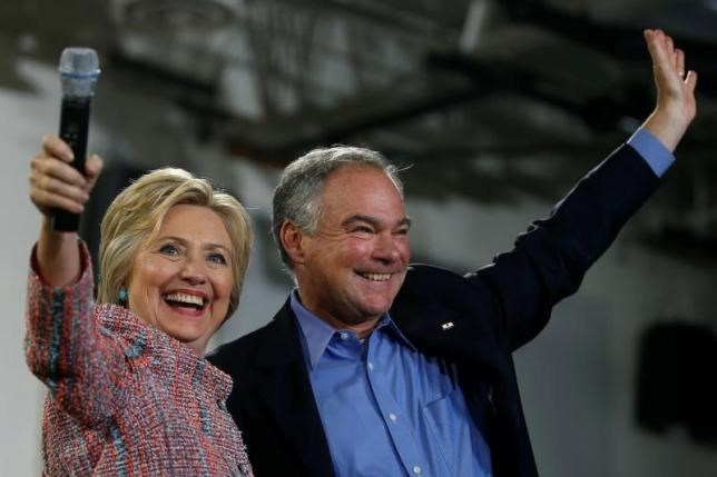 Democratic U.S. presidential candidate Hillary Clinton and U.S. Senator Tim Kaine (D-VA) wave to the crowd during a campaign rally at Ernst Community Cultural Center in Annandale, Virginia, U.S., July 14, 2016.