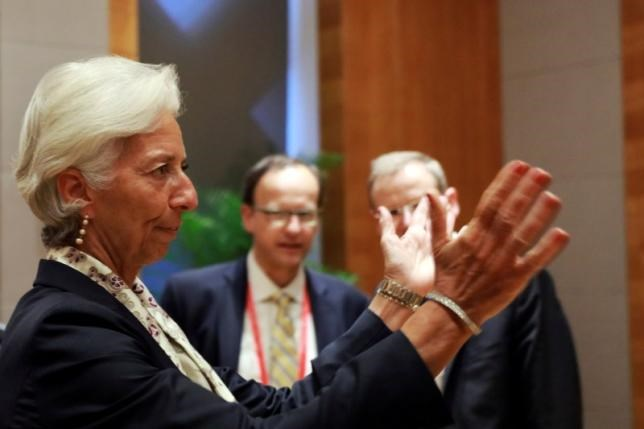 Christine Lagarde, Managing Director of the International Monetary Fund reacts to photographers before attending the G20 High-level Tax Symposium held in Chengdu, China, July 23, 2016.