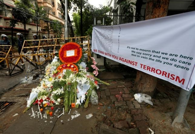 Wreaths and flowers, offered by people to pay tribute to the victims of the attack on the Holey Artisan Bakery and the O'Kitchen Restaurant, are pictured at a makeshift memorial near the attack site, in Dhaka, Bangladesh, July 5, 2016.