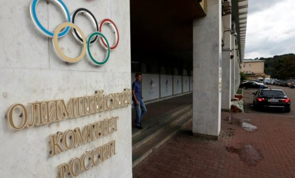 A man walks out of the Russian Olympic Committee headquarters building in Moscow, Russia, July 20, 2016.