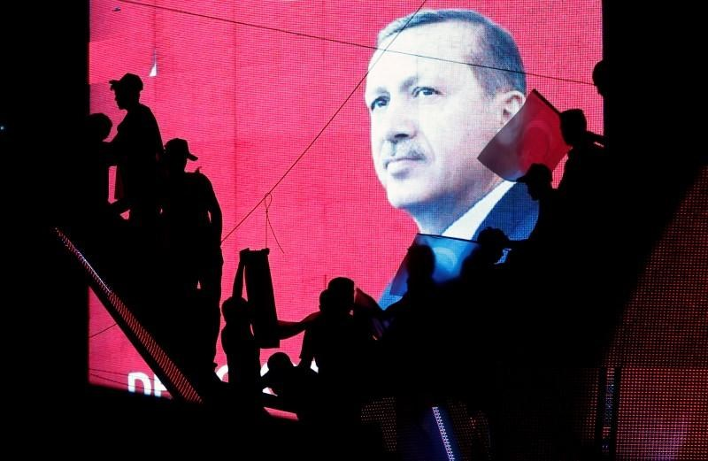 Turkish Supporters are silhouetted against a screen showing President Tayyip Erdogan during a pro-government demonstration in Ankara, Turkey, July 17, 2016.