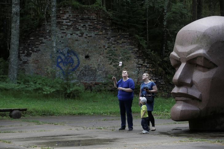 People take a selfie at the abandoned former Soviet R12 nuclear missile launch site in Zeltini. The Zeltini missile launch site, operational during the Cold War years from 1962 to 1984 when Latvia was under Soviet rule, at one time concealed at least eight nuclear missiles in its hangars.