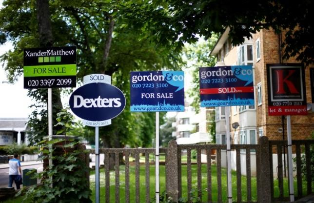 Estate agents boards are lined up outside houses in south London, Britain June 3, 2014.