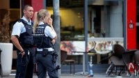 Police stand outside where a 21-year-old Syrian refugee killed a woman with a machete and injured two other people in the city of Reutlingen, Germany July 24, 2016.