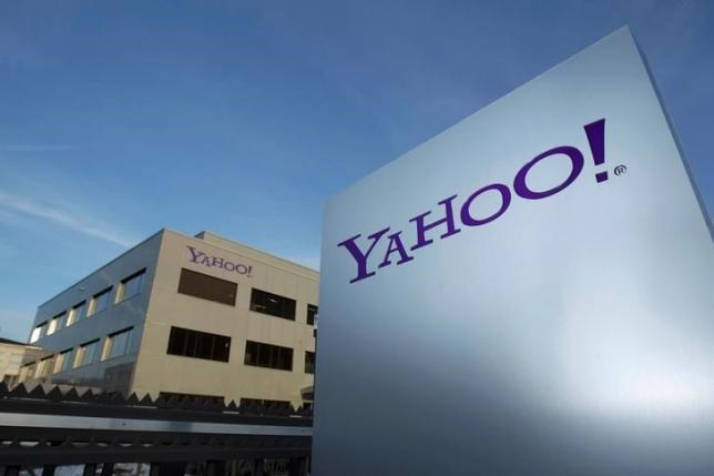 A Yahoo logo is pictured in front of a building in Rolle, 30 km (19 miles) east of Geneva, December 12, 2012.