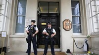 Armed police stand guard outside the French embassy in London, Britain July 15, 2016.