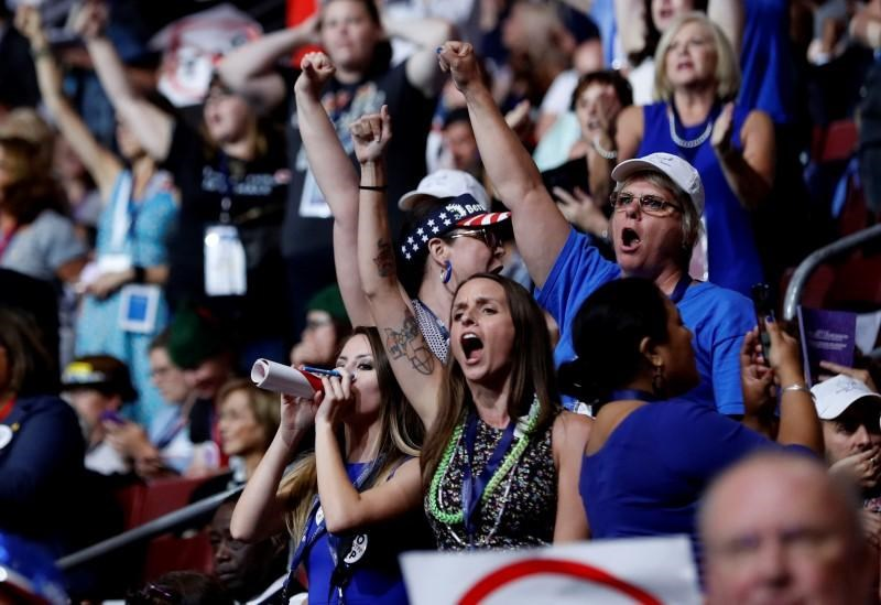 Supporters of Senator Bernie Sanders chant his name as they protest on the floor during the first day of the Democratic National Convention in Philadelphia, Pennsylvania, U.S. July 25, 2016.