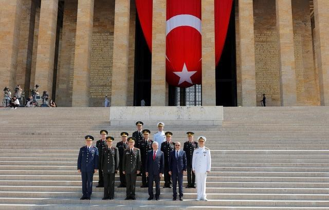Turkey's Prime Minister Binali Yildirim (3rd R), Chief of Staff General Hulusi Akar (3rd L), Defense Minister Fikri Isik (2nd R) and the country's top generals pose in Anitkabir, the mausoleum of modern Turkey's founder Mustafa Kemal Ataturk, after a wreath-laying ceremony ahead of a High Military Council meeting in Ankara, Turkey, July 28, 2016.