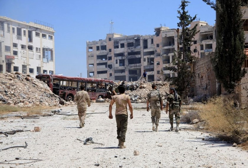 Syrian government forces patrol in the northwest outskirts of Aleppo on July 28, 2016