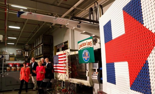 Democratic presidential candidate Hillary Clinton and vice presidential candidate Senator Tim Kaine (D-VA), along with former president Bill Clinton, Anne Kaine and Pennsylvania Governor Tom Wolf arrive for an event at K'NEX in Hatfield, Pennsylvania, July 29, 2016.