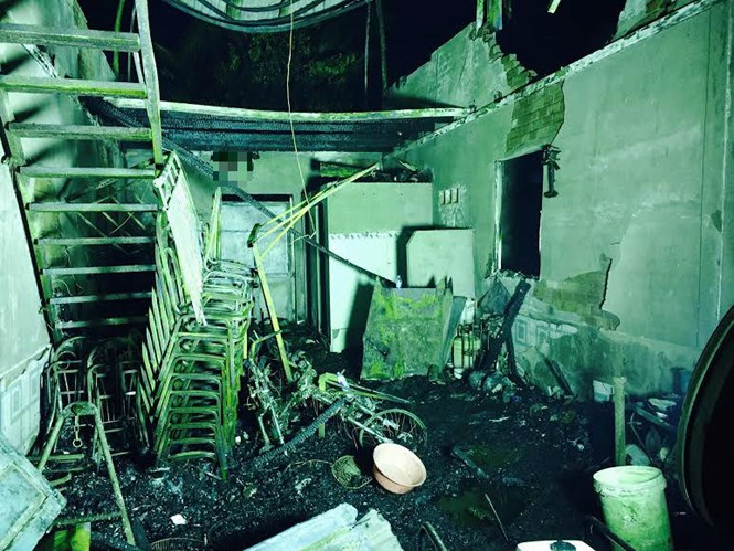 The blaze ripped through the house at midnight when the victims were asleep