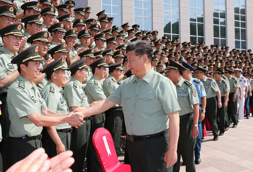 Xi Jinping meets with delegates during an inspection of the army's headquarters on July 27. Photographer: Li Gang/Xinhua via Getty Images