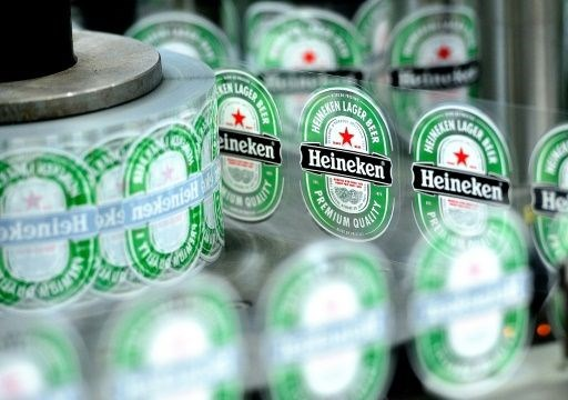 Heineken fizz falls flat as half-year profits drop