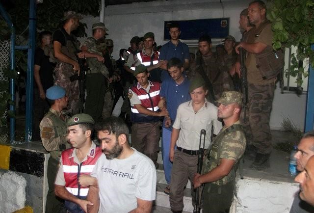 Turkish gendarmeries escort fugitive commandos who were involved in a bid to seize President Tayyip Erdogan during a failed coup attempt last month, as they leave from a gendarmerie station in Mugla province, Turkey, early August 1, 2016.