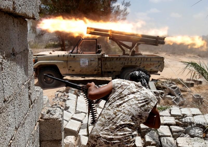 Libyan forces allied with the U.N.-backed government fire weapons during a battle with IS fighters in Sirte, Libya, July 21, 2016.