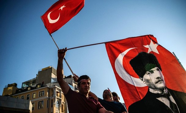 A demonstrator waves the national flag during a rally to condemn the coup attempt against President Recep Tayyip Erdogan in Istanbul on July 24, 2016