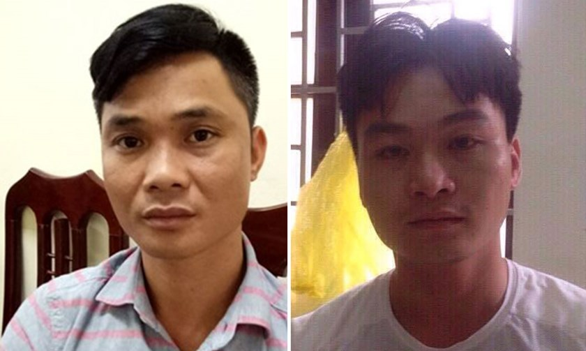 Nguyen Van Thuy (R) and Nguyen Quang Duyen are accused of assaulting a police officer on Tuesday evening