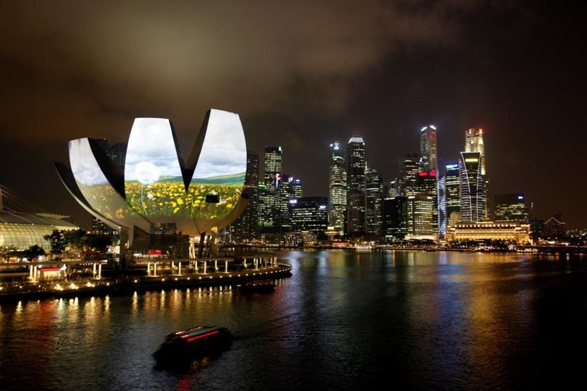 Garden of Light, an animation by Hexogon Solution of Singapore, is projected on the ArtScience Museum during a media preview of the i Light Marina Bay sustainable light art festival in Singapore March 7, 2012.
