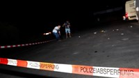 Cameramen film at the scene where a man was shot dead by the police after attacking passengers on a train with an ax near the city of Wuerzburg, Germany July 19, 2016.