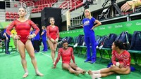 (L-R) US gymnasts Alexandra Raisman, Lauren Hernandez, Simone Biles and Gabrielle Douglas take part in a training session at the women's Artistic gymnastics at the Olympic Arena on August 4, 2016 ahead of the Rio 2016 Olympic Games in Rio de Janeiro