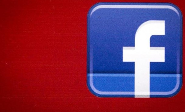 A Facebook logo is displayed on the side of a tour bus in New York's financial district July 28, 2015.