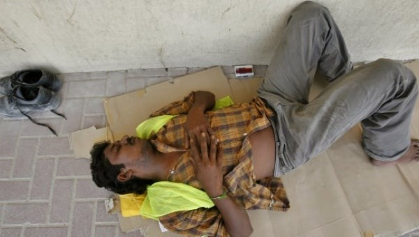 An Indian worker gets some rest during a very hot summer in Dubai, United Arab Emirates, Sept. 3, 2007