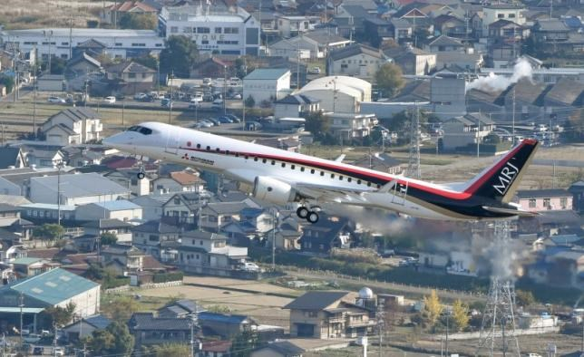 An aerial view shows Mitsubishi Aircraft Corp's Mitsubishi Regional Jet (MRJ) taking off for a test flight at Nagoya Airfield in Toyoyama town, Aichi Prefecture, central Japan, in this photo released by Kyodo November 11, 2015.