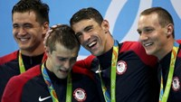 Michael Phelps (USA), Ryan Held (USA), Caeleb Dressel (USA) and Nathan Adrian (USA) of USA celebrate on the podium