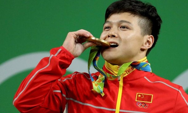 Long Qingquan (CHN) of China (PRC) poses with his medal.