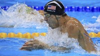 Michael Phelps (USA) of USA competes on the way to winning the gold medal.
