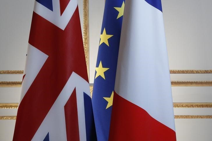 Britain, European and French flags are seen before a news conference at the Elysee Palace in Paris, France, July 21, 2016.