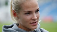 Darya Klishina of Russia talks to the media after competing.