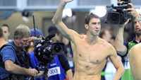 Michael Phelps (USA) of USA reacts.