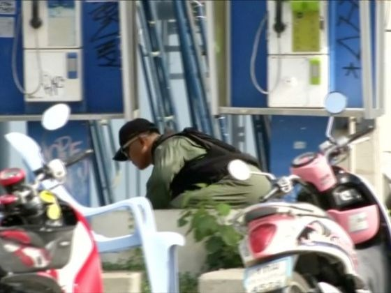 Explosive Ordnance Disposal (EOD) official checks at the scene of a bomb blast in Hua Hin.
