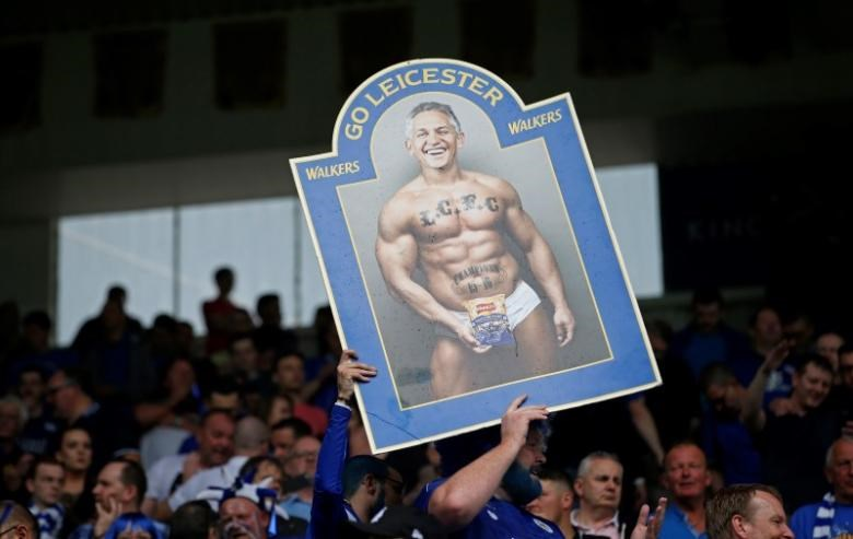 Leicester fans hold up a Gary Lineker banner before the match
