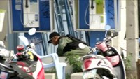 Explosive Ordnance Disposal (EOD) official checks at the scene of a bomb blast in Hua Hin, south of Bangkok, Thailand, in this still image taken from video August 12, 2016.